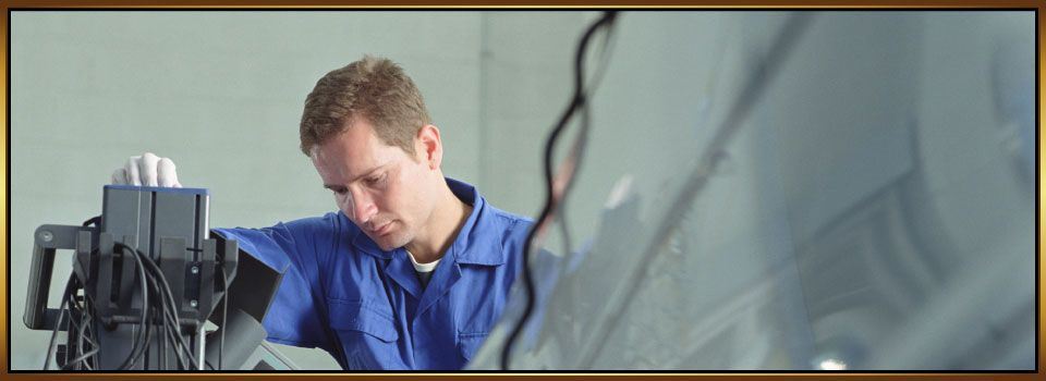 Maintenance Technician Looking at Diagnostic Equipment